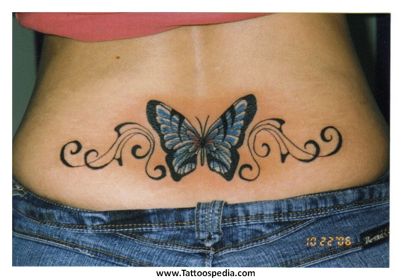 Tiger eyes tattoos lower back - photo#6